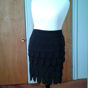 NWT. Pull-on black skirt with layers of U cuts